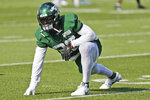FILE - In this July 25, 2019, file photo, New York Jets running back Le'Veon Bell takes part in practice at the NFL football team's training camp in Florham Park, N.J. Bell sat out last season in a contract dispute with Pittsburgh and signed a four-year, $52.5 million contract with New York in March. (AP Photo/Seth Wenig, File)