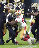 New Orleans Saints quarterback Drew Brees (9) is sacked by San Francisco 49ers' Kentavius Street (95) during the second quarter of an NFL football game in New Orleans, Sunday, Nov. 15, 2020. Brees has been diagnosed with multiple rib fractures and a collapsed right lung, a person with knowledge of the situation said Monday. The person spoke on condition of anonymity because the Saints have not announced specifics about Brees' injury, which the 41-year-old quarterback said occurred on a heavy hit by Street in the second quarter of New Orleans victory over the Niners on Sunday. (Max Becherer/The Advocate via AP)