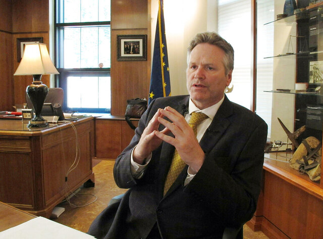 FILE - In this May 29, 2019 file photo, Alaska Gov. Mike Dunleavy speaks to reporters in his office at the state Capitol in Juneau, Alaska. Dunleavy said he hopes to move past the rancor of his first year in office, amid an unsettled dispute with lawmakers over state spending and threat of a recall effort looming large. The Republican will mark a full year in office Tuesday, Dec. 3. (AP Photo/Becky Bohrer, File)