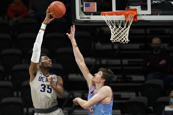 Shawnee State forward EJ Onu (35) shoots over Lewis-Clark State forward Trystan Bradley during the first half of the final of the NAIA men's basketball tournament in Kansas City, Mo., Tuesday, March 23, 2021. (AP Photo/Orlin Wagner)