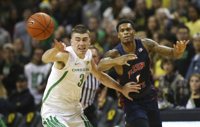 Oregon's Payton Pritchard, left, forces a turnover against Fresno State's New Williams during the first half of an NCAA college basketball game in Eugene, Ore., Tuesday, Nov. 5, 2019. (AP Photo/Chris Pietsch)