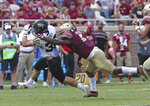 Wake Forest's Cade Carney tries to escape the tackle of Florida State's Dontavious Jackson in the second quarter of an NCAA college football game, Saturday, Oct. 20, 2018 in Tallahassee, Fla. Florida State won 38-17. (AP Photo/Steve Cannon)