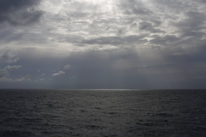 In this photo taken on Sunday, Sept. 8, 2019, the sun shines over international waters north of Libya in the Mediterranean Sea. At least 11 migrants trying to reach Europe, including a pregnant woman, drowned Sunday, Oct. 25, 2020 when their boat capsized off the coast of Libya, the U.N. migration agency said, making it the third migrant shipwreck in the Mediterranean Sea in a week. (AP Photo/Renata Brito)