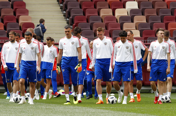 Russia players arrives at the official training session of the Russian team one the eve of the group A match between Russia and Saudi Arabia at the 2018 soccer World Cup at Luzhniki stadium in Moscow, Russia, Wednesday, June 13, 2018. (AP Photo/Antonio Calanni)