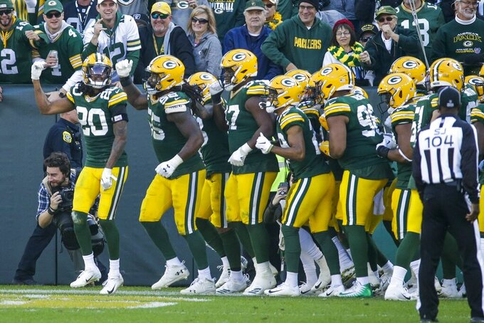 Green Bay Packers' Kevin King celebrates his interception with teammates during the second half of an NFL football game Sunday, Oct. 20, 2019, in Green Bay, Wis. (AP Photo/Mike Roemer)