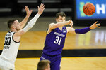 Northwestern forward Robbie Beran (31) passes ahead of Iowa guard Connor McCaffery, left, during the first half of an NCAA college basketball game, Tuesday, Dec. 29, 2020, in Iowa City, Iowa. (AP Photo/Charlie Neibergall)