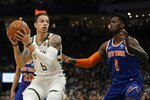 Milwaukee Bucks' D.J. Wilson tries to get past New York Knicks' Bobby Portis during the second half of an NBA basketball game Tuesday, Jan. 14, 2020, in Milwaukee. (AP Photo/Morry Gash)