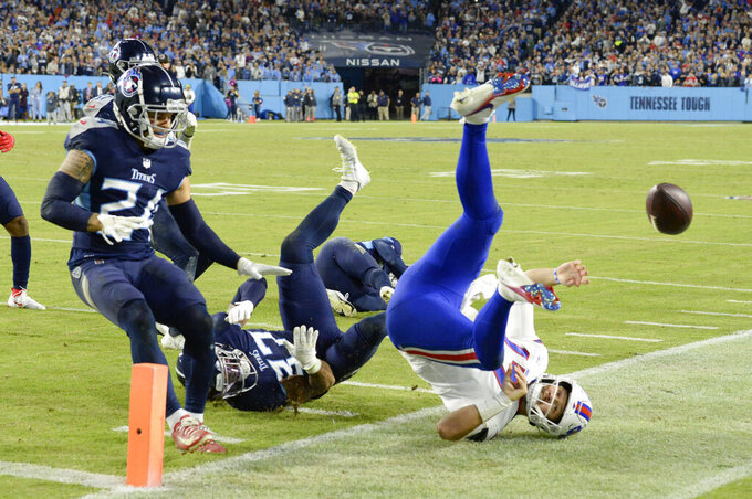 Buffalo Bills quarterback Josh Allen (17) is stopped short of the goal line by Tennessee Titans safety Amani Hooker (37) in the second half of an NFL football game Monday, Oct. 18, 2021, in Nashville, Tenn. (AP Photo/Mark Zaleski)