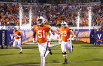 Virginia players take the field for an NCAA college football game against William & Mary in Charlottesville, Va., Friday, Sept. 6, 2019. (AP Photo/Andrew Shurtleff)