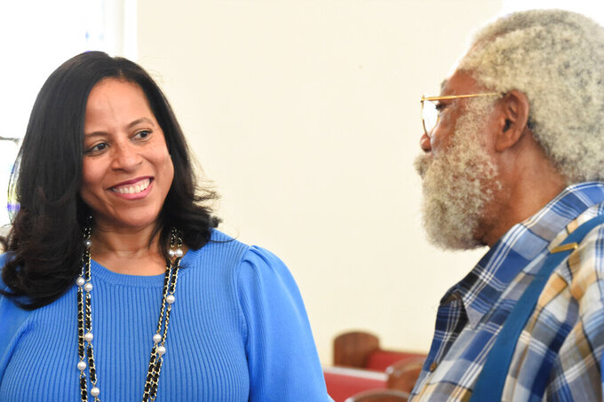 State Sen. Mia McLeod, left, stands in the sanctuary of Shiloh Baptist, her family's church, talking with Rev. Coley Mearite, Tuesday, June 1, 2021, in Bennettsville, S.C. In her challenge of Gov. Henry McMaster, the Columbia Democrat is the first Black woman to seek South Carolina's top job. (AP Photo/Meg Kinnard)