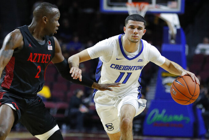 """FILE - Creighton's Marcus Zegarowski (11) drives around San Diego State's Adam Seiko (2) during the first half of an NCAA college basketball game in Las Vegas, in this Thursday, Nov. 28, 2019, file photo. Zegarowski announced he's leaving Creighton and declaring for the NBA draft.  """"I will be entering the 2021 NBA draft and look forward to continuing to work hard, chase my dreams and play the game I love,"""" Zegarowski tweeted Tuesday, April 13,. 2021.  (AP Photo/John Locher, File)"""