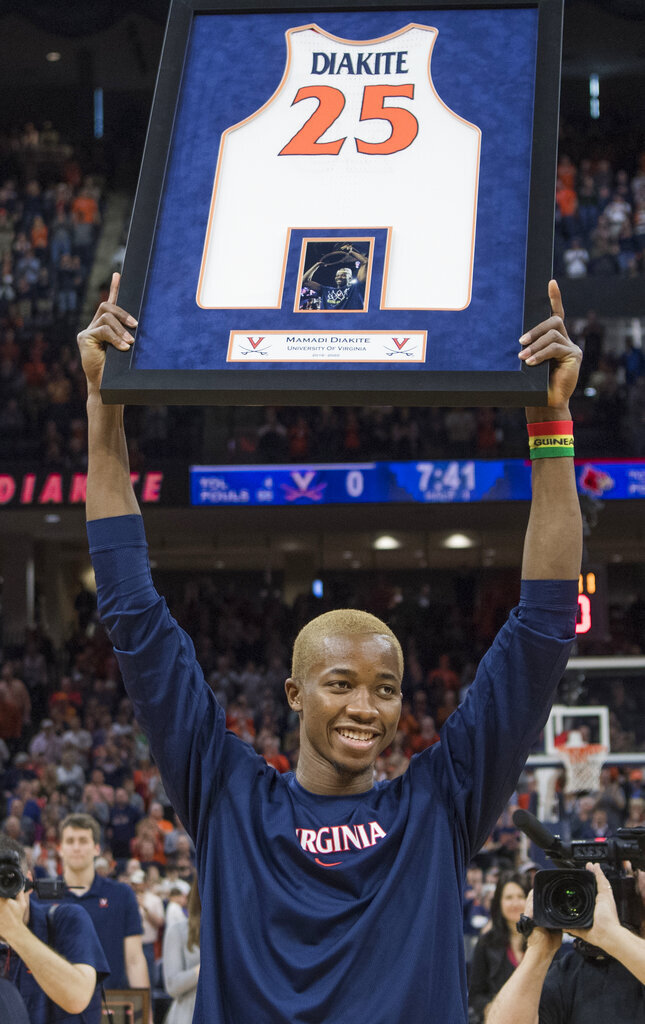Virginia forward Mamadi Diakite was one of three players honored with a framed jersey before an NCAA college basketball game against Louisville in Charlottesville, Va., Saturday, March 7, 2020. (AP Photo/Lee Luther Jr.)