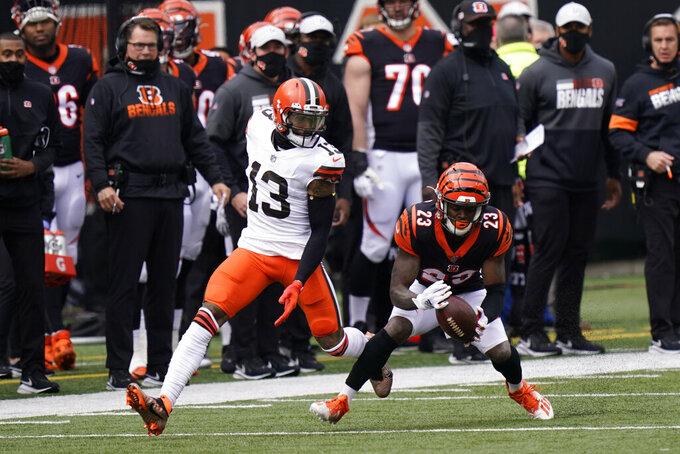 Cincinnati Bengals' Darius Phillips (23) intercepts a pass intended for Cleveland Browns' Odell Beckham Jr. (13) during the first half of an NFL football game, Sunday, Oct. 25, 2020, in Cincinnati. (AP Photo/Bryan Woolston)