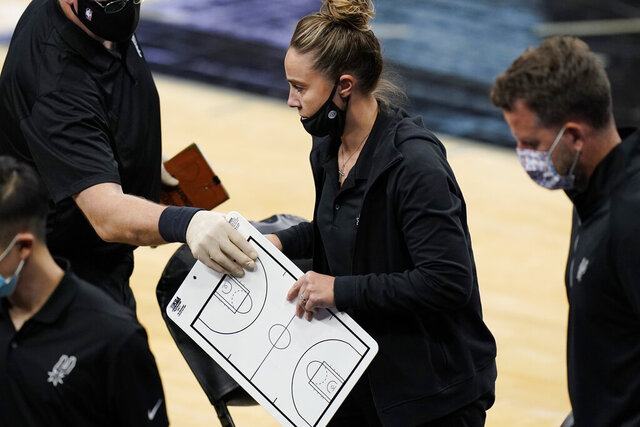 San Antonio Spurs assistant coach Becky Hammon breaks from a huddle during a timeout in the second half of an NBA basketball game against the Los Angeles Lakers in San Antonio, Wednesday, Dec. 30, 2020. Hammon became the first woman to direct an NBA team, taking over the Spurs after coach Gregg Popovich was ejected in a 121-107 loss to the Lakers. (AP Photo/Eric Gay)