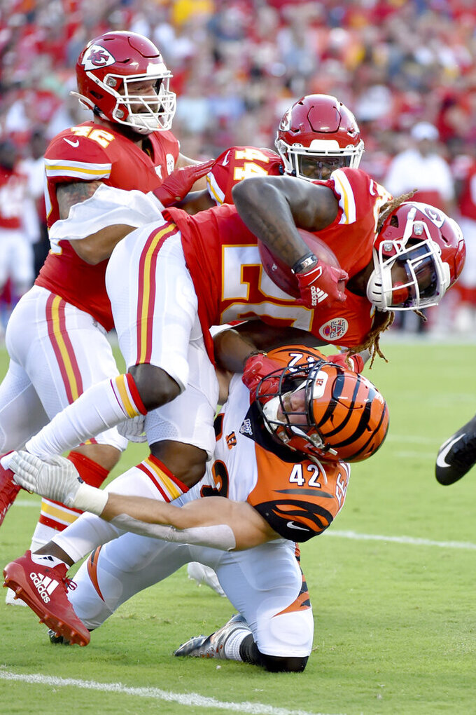 Cincinnati Bengals safety Clayton Fejedelem (42) tackles Kansas City Chiefs running back Tremon Smith (20) during the first half of an NFL preseason football game in Kansas City, Mo., Saturday, Aug. 10, 2019. (AP Photo/Ed Zurga)