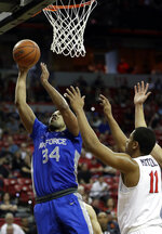 Air Force's Ryan Swan-Ford (34) shoots as San Diego State's Matt Mitchell defends during the first half of a Mountain West Conference tournament NCAA college basketball game Thursday, March 5, 2020, in Las Vegas. (AP Photo/Isaac Brekken)