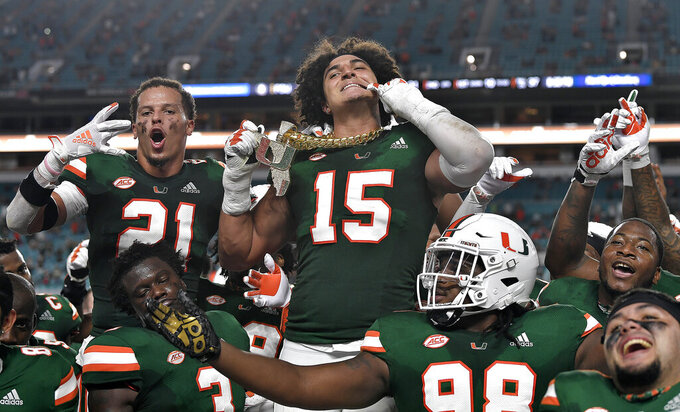 Miami lineman Jaelan Phillips displays the tunover chain after intercepting a Florida State pass during the first half of an NCAA college football game Saturday, Sept. 26, 2020, in Miami Gardens, Fla. (Michael Laughlin/South Florida Sun-Sentinel via AP)