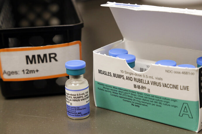 """FILE - This May 15, 2019 file photo shows a vial of a measles, mumps and rubella vaccine at a clinic in Vashon Island, Wash. The World Health Organization says there has been a """"dramatic resurgence"""" of measles in Europe, with nearly 90,000 people sickened by the virus in the first half of 2019. In a new report issued Thursday, Aug. 29 the U.N. health agency said the number of measles cases from January to June this year is double the number reported for the same period in 2018. (AP Photo/Elaine Thompson, file)"""