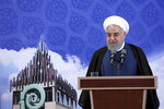 In this photo released by the official website of the office of the Iranian Presidency, President Hassan Rouhani speaks in a ceremony to inaugurate Azadi Innovation Factory in Pardis technology park in west of Tehran, Iran, Tuesday, Nov. 5, 2019. Rouhani announced on Tuesday that Tehran will begin injecting uranium gas into 1,044 centrifuges, the latest step away from its nuclear deal with world powers since President Donald Trump withdrew from the accord over a year ago. (Office of the Iranian Presidency via AP)