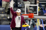 Alabama head coach Nate Oats waves to fans after cutting down the net after the championship game of the NCAA college basketball Southeastern Conference Tournament against LSU Sunday, March 14, 2021, in Nashville, Tenn. Alabama won 80-79. (AP Photo/Mark Humphrey)