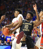 Florida forward Omar Payne (5) grabs a rebound away from Florida State forward Malik Osborne (10) during the first half of an NCAA college basketball game Sunday, Nov. 10, 2019, in Gainesville, Fla. (AP Photo/Matt Stamey)
