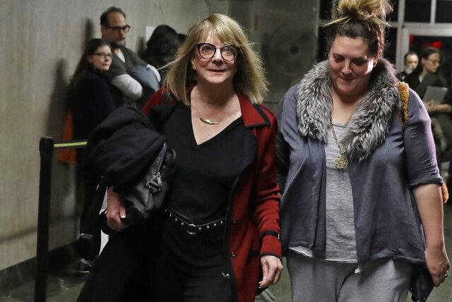 Psychologist Elizabeth Loftus, left, leaves the Harvey Weinstein rape trial, in New York, Friday, Feb. 7, 2020. (AP Photo/Richard Drew)
