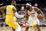 Los Angeles Lakers forward LeBron James (23) grabs Houston Rockets guard James Harden (13) after a rebound during the first half of an NBA basketball game Saturday, Jan. 18, 2020, in Houston. (AP Photo/Michael Wyke)
