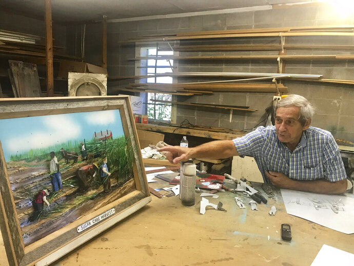 In this Sept. 5, 2019, photo, Opelousas metal artist Carroll Gautreaux talks about hand-cutting the wispy sugar cane in his three-dimensional painting