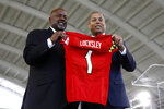 Maryland's new head football coach Mike Locksley, left, and athletic director Damon Evans pose during an NCAA college football news conference, Thursday, Dec. 6, 2018, in College Park, Md. Locksley, Alabama's offensive coordinator, will take over at Maryland after the most tumultuous year in the program's recent history. (AP Photo/Patrick Semansky)