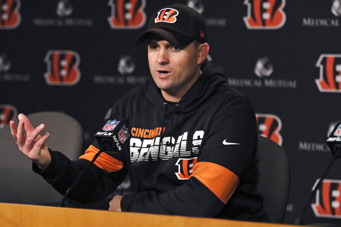 Cincinnati Bengals head coach Zac Taylor speaks during a news conference after an NFL football game against the Cleveland Browns, Sunday, Dec. 29, 2019, in Cincinnati. The Bengals won 33-23. (AP Photo/Gary Landers)