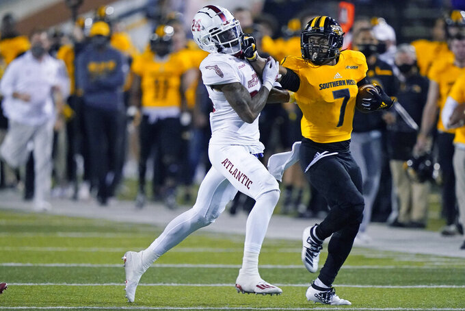 Southern Mississippi running back Darius Maberry (7) pushes away Florida Atlantic safety Zyon Gilbert (24) during the second half of an NCAA college football game, Thursday, Dec. 10, 2020, in Hattiesburg, Miss. (AP Photo/Rogelio V. Solis)