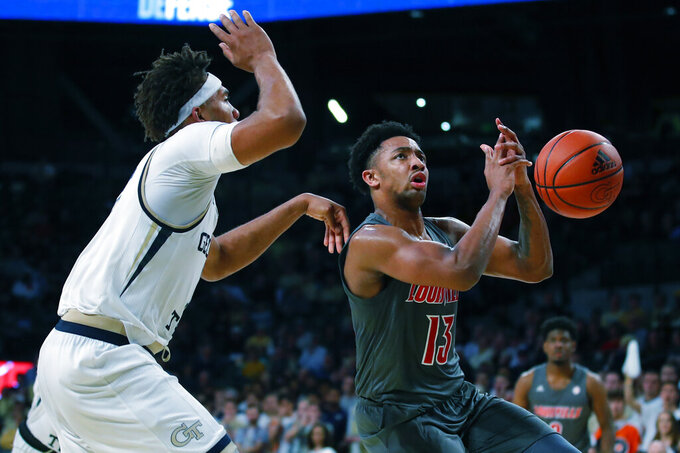 Louisville guard David Johnson (13) loses control of the ball during the second half of an NCAA college basketball game against Georgia Tech in Atlanta, Wednesday, Feb. 12, 2020. (AP Photo/Todd Kirkland)
