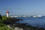 This May 2, 2020 shows the Mann beach lighthouse and boats anchored in Naufragio Bay, amid the new coronavirus pandemic, in San Cristobal, Galapagos Islands, Ecuador.