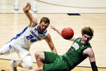 Creighton guard Mitch Ballock (24) draws the foul from Ohio forward Ben Vander Plas (5) in the first half of a second-round game in the NCAA men's college basketball tournament at Hinkle Fieldhouse in Indianapolis, Monday, March 22, 2021. (AP Photo/Michael Conroy)