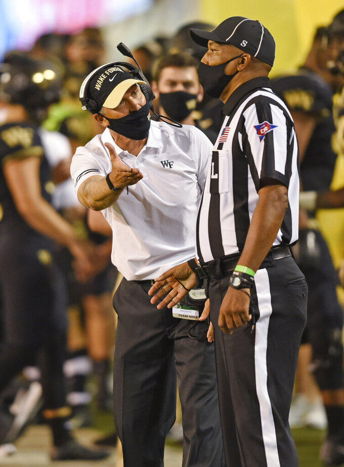 Wake Forest coach Dave Clawson complains that there was no pass interference call in the second half against Clemson during an NCAA college football game Saturday, Sept. 12, 2020, in Winston-Salem, N.C. (Walt Unks/The Winston-Salem Journal via AP)