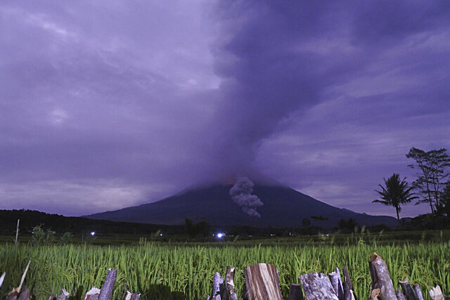 Volcanic materials spew from the crater of Mount Semeru in Lumajang, East Java, Indonesia, Tuesday, Dec. 1, 2020. Indonesian authorities are closely monitoring several volcanoes after sensors picked up increased activity in recent weeks, prompting the evacuation of thousands of people. (AP Photo)
