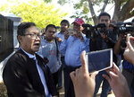 Khin Maung Zaw, left, a lawyer of two Reuters journalists, Wa Lone and Kyaw Soe Oo, talks to journalists as he leaves the Supreme Court after submitting appeal documents of the two journalists in Naypyitaw, Myanmar, Friday, Feb. 1, 2019. Lawyers for the two journalists sentenced to seven years in jail on charges of breaking the Official Secrets Act filed an appeal to the country's supreme court, after a high court judge rejected their appeal in January. (AP Photo/Aung Shine Oo)