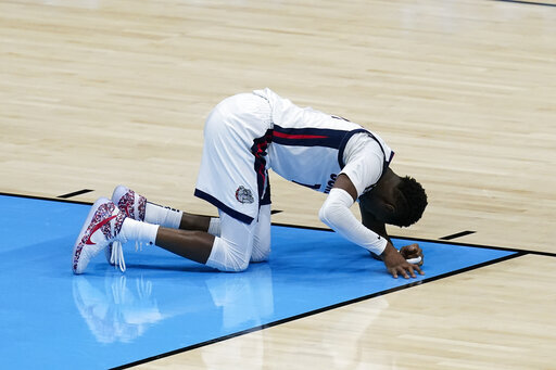 Gonzaga guard Joel Ayayi rests on the court after getting injured during the second half of the championship game against Baylor in the men's Final Four NCAA college basketball tournament, Monday, April 5, 2021, at Lucas Oil Stadium in Indianapolis. (AP Photo/Darron Cummings)