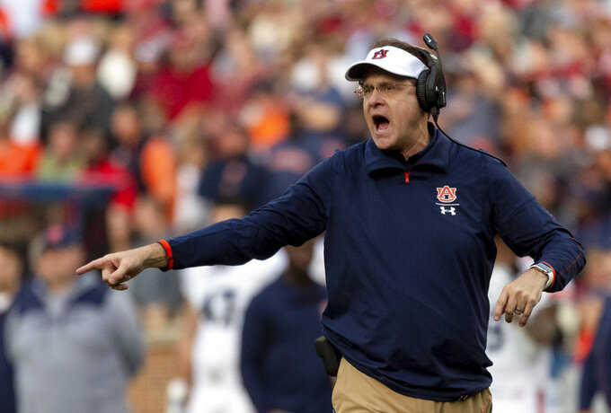 Auburn head coach Gus Malzahn yells about a replay call during the first half of an NCAA college football game against Alabama, Saturday, Nov. 24, 2018, in Tuscaloosa, Ala. (AP Photo/Vasha Hunt)