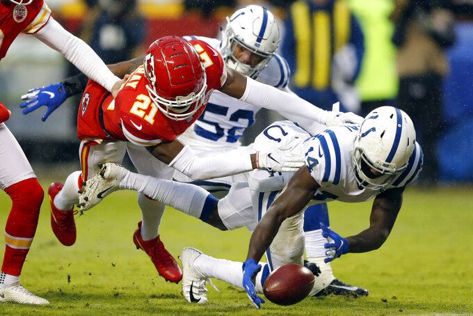 Indianapolis Colts wide receiver Zach Pascal (14) scores a touchdown against Kansas City Chiefs safety Eric Murray (21) after a punt by Kansas City Chiefs punter Dustin Colquitt was blocked by linebacker Najee Goode, during the first half of an NFL divisional football playoff game in Kansas City, Mo., Saturday, Jan. 12, 2019. (AP Photo/Charlie Neibergall)