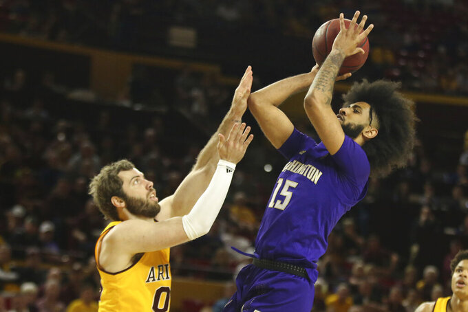 Washington's Marcus Tsohonis (15) shoots over Arizona State's Mickey Mitchell (00) during the first half of an NCAA college basketball game Thursday, March 5, 2020, in Tempe, Ariz. (AP Photo/Darryl Webb)