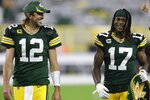 Green Bay Packers' Aaron Rodgers and Davante Adams smile as they walk off the field after an NFL football game against the Detroit Lions Monday, Sept. 20, 2021, in Green Bay, Wis. The Packers won 35-17. (AP Photo/Matt Ludtke)