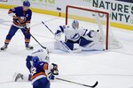 New York Islanders' Josh Bailey (12) shoots the puck past Tampa Bay Lightning goaltender Andrei Vasilevskiy (88) for a goal as Islanders' Anders Lee (27) and  Lightning's Ryan McDonagh (27) watch during the third period of an NHL hockey game Friday, Nov. 1, 2019, in Uniondale, N.Y. The Islanders won 5-2. (AP Photo/Frank Franklin II)