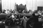 FILE - In this Aug. 3, 1973, file photo, the Senate Watergate Committee hearings continueon Capitol Hill in Washington. From left are: Sen. Lowell P. Weicker, Jr; Sen. Edward J. Gurney, Fred Thompson, Sen. Howard H. Baker, Jr; Rufus Edmisten, Sen. Sam Ervin; Sam Dash, Sen. Joseph M. Montoya, Sen. Daniel K. Inouye was absent. Testifying is Lt. Gen. Vernon Walters. In 1973, millions of Americans tuned in to what Variety called