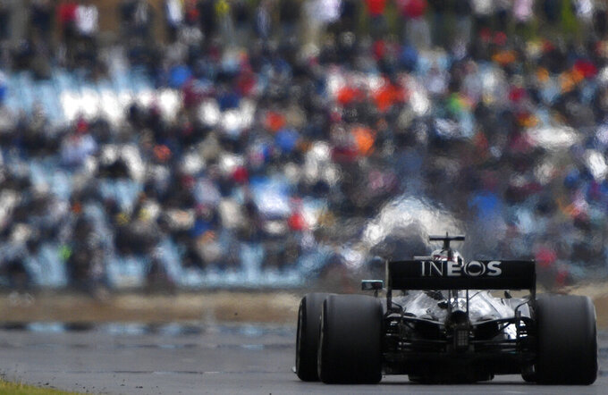 Mercedes driver Lewis Hamilton of Britain steers his car during the Formula One Portuguese Grand Prix at the Algarve International Circuit in Portimao, Portugal, Sunday, Oct. 25, 2020. (Rudy Carezzevoli, Pool via AP)
