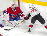 Montreal Canadiens goaltender Carey Price (31) stops Ottawa Senators centre Chris Tierney (71) during first period NHL hockey action in Montreal, Wednesday, Nov. 20, 2019. (Ryan Remiorz/The Canadian Press via AP)
