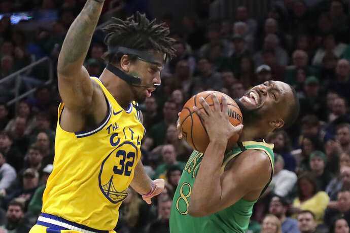 Boston Celtics guard Kemba Walker, right, drives against Golden State Warriors forward Marquese Chriss (32) during the second quarter of an NBA basketball game, Thursday, Jan. 30, 2020, in Boston. (AP Photo/Elise Amendola)