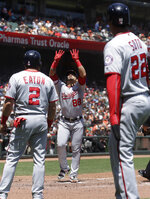 Washington Nationals' Gerardo Parra, center, celebrates after hitting a three-run home run that scored Adam Eaton (2) and Juan Soto (22) against the San Francisco Giants during the third inning of a baseball game in San Francisco, Wednesday, Aug. 7, 2019. (AP Photo/Jeff Chiu)