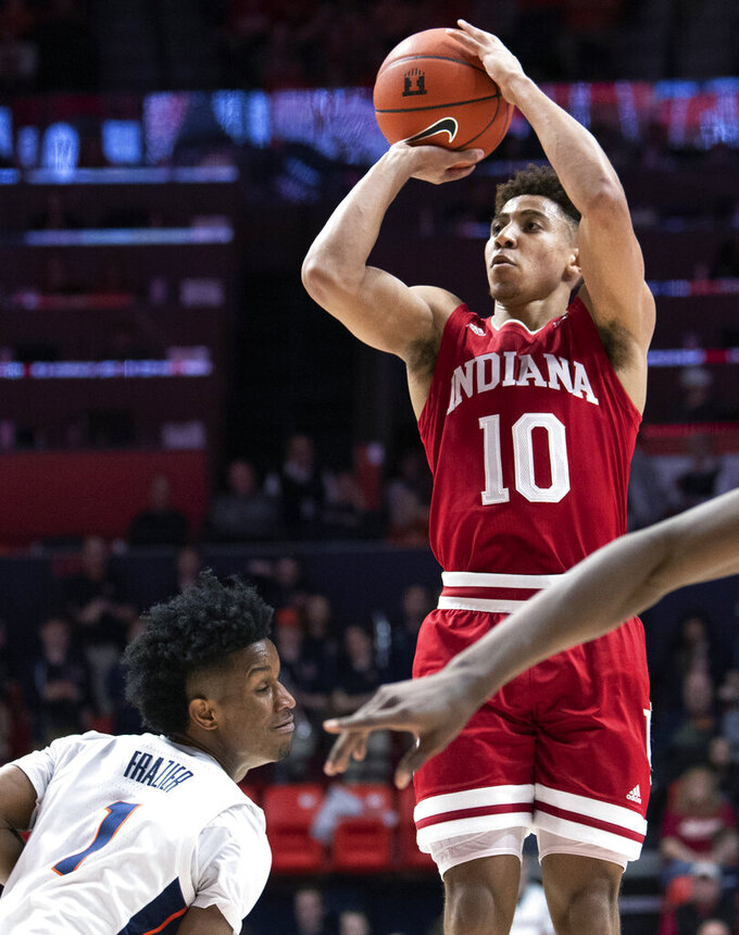 Indiana guard Rob Phinisee (10) shoots over Illinois guard Trent Frazier (1) during the second half of an NCAA college basketball game in Champaign, Ill., Thursday, March 7, 2019. (AP Photo/Stephen Haas)