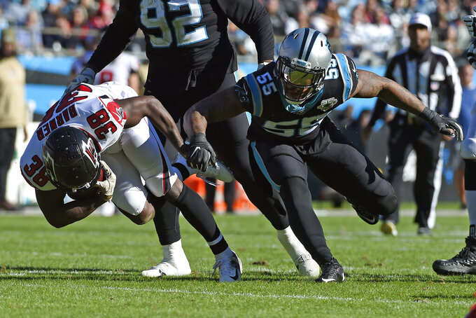 Atlanta Falcons running back Kenjon Barner (38) runs the ball while Carolina Panthers linebacker Bruce Irvin (55) defends during the first half of an NFL football game in Charlotte, N.C., Sunday, Nov. 17, 2019. (AP Photo/Mike McCarn)